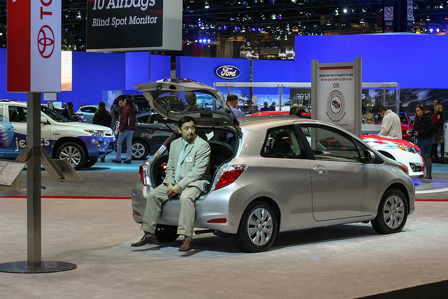 Salesman waiting in a Yaris